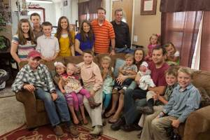 Some of the Duggar clan surrounding Josh and Anna and new baby Marcus Anthony Duggar.