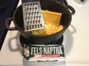1.  Grate (1) Fels-Naptha Bar into a small pot. (I have a pot, grater and spoon especially allocated for making laundry soap)