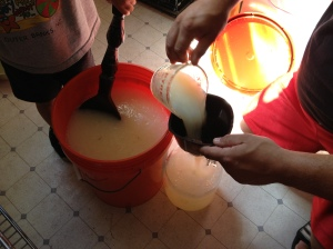 21.  Using a large funnel and the measuring cup, add the soap mixture to your jug all the way to the top.