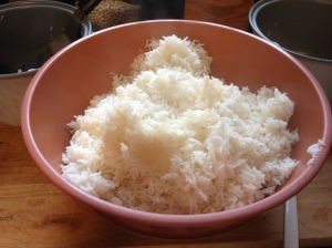 Put hot cooked rice into a very large bowl.