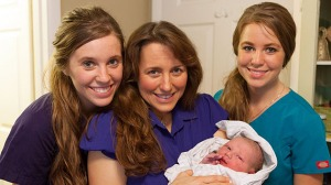Michelle Duggar, mom to Jana and Jill (and 17 others!), and new Grandma to 3 kiddies (little Marcus shown here)